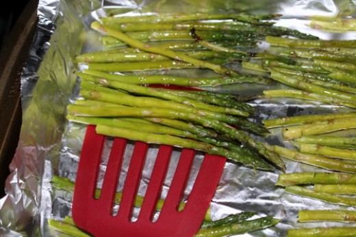 Turn the asparagus by shaking the pan or using a spatula