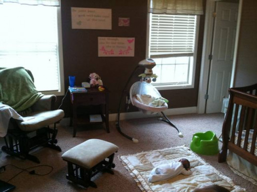 Swing, Glider, Night Table, Bumbo Seat, Bedding (what she's using as a mat)
