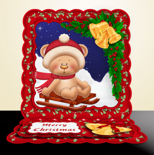 An easel card with sledging Santa Bear made from a printable download from craftsuprint.