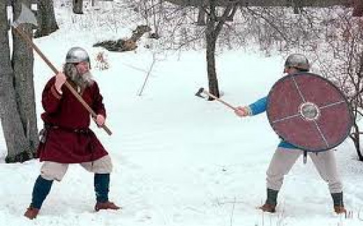 Winter combat training - the man on the left has the two-handed Dane axe, the man on the right a short-handled fighting axe and shield. Which has the advantage?