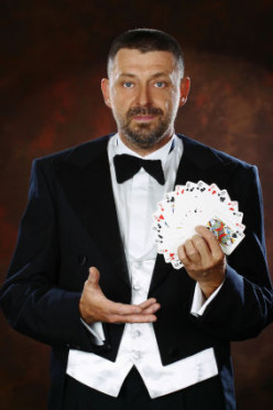 "Card Trick: How To Perform ""Four Piles."""