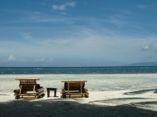Empty beach chairs, Ananyana Beach Resort, Panglao Island, Bohol, Philippines. Copyright Rod Martin, Jr.