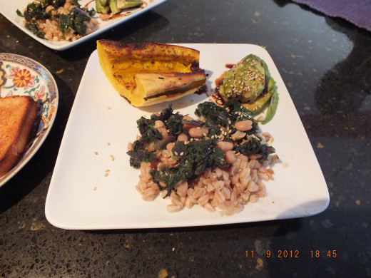 White beans and kale over farro with delecta squash, avocado and rye toast. Crazy good!