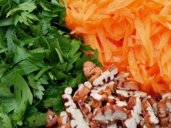 Grated carrot, parsley and roughly chopped pecans for the Kosher Carrot Salad Recipe.