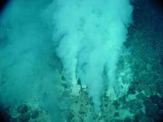 Methane plumes are observed rising from the seafloor.