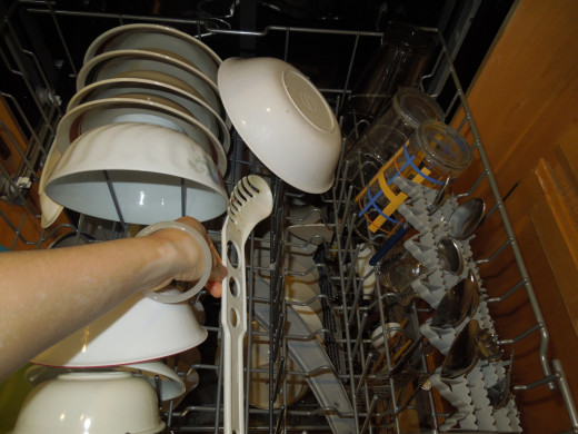 Place Long Cooking Utensils Flat on the Upper Rack of A Dishwasher