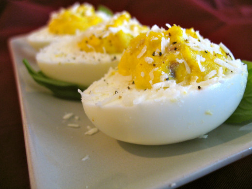 Use homemade Caesar dressing in place of mayo for deviled eggs with a twist. Top them off with freshly-grated cheese.