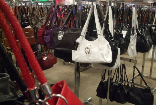 Handbag section of a retail store.