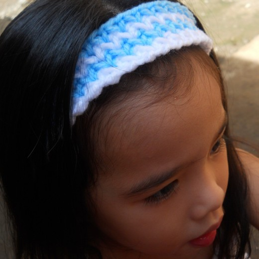 My beautiful first daughter wearing the headband I made for her. She's just so adorable!