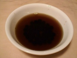 Cooked tapioca pearls in a bowl and boiled with brown sugar.