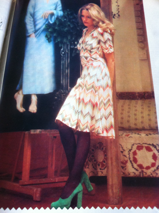 Demure- look, fitted dress with colored platform shoes.  Photo taken of a page in my 70s magazine collection.
