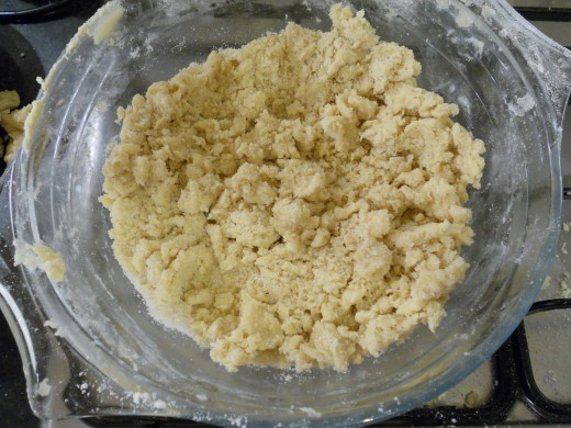 Keep kneading your mix until you have the consistency and texture of breadcrumbs