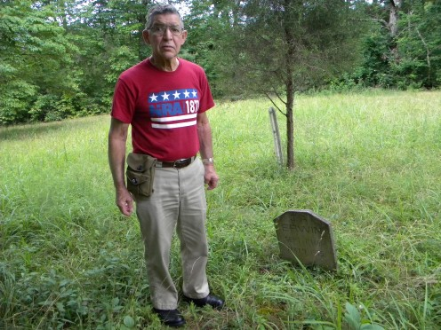 My father, James L. Erwin, standing next to the grave marker he made for his father.