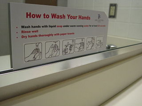 A sign, illustrated with graphics, showing the proper method of washing hands.