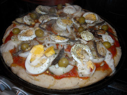 An example of a pizza with plenty of toppings.