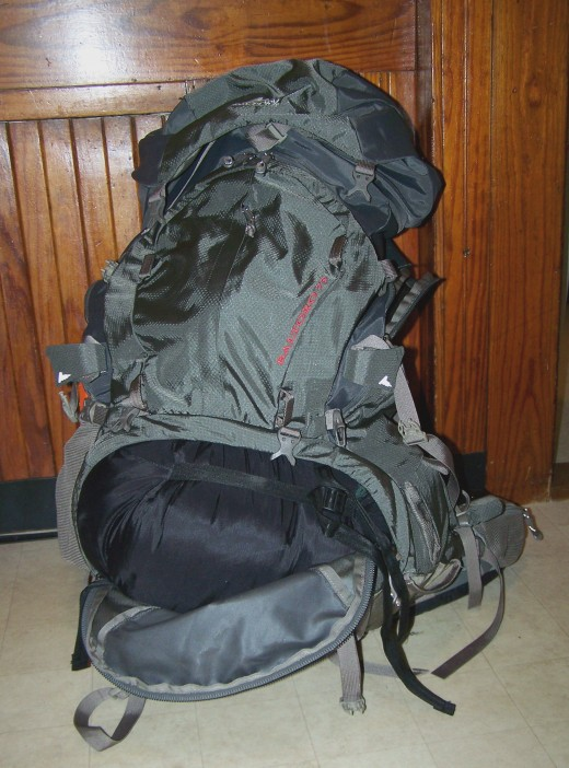 A sleeping bag in the very bottom compartment of the pack.