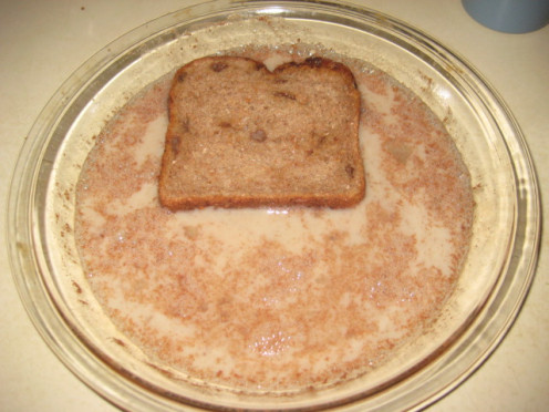 coat both sides of bread slices; sprouted whole grain raisin bread pictured.