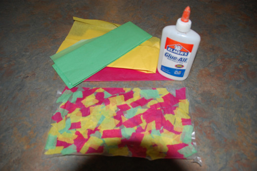 tissue paper pieces glued onto wax paper