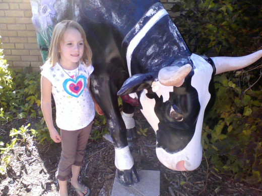 my daughter and one of the local cows