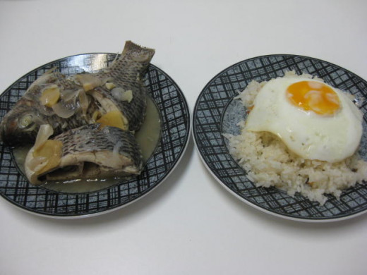 Paksiw na Tilapia can be eaten in the morning for breakfast with fried rice and fried egg sunny side up.