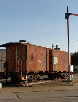 The semafore signal is one way to signal that a train is approaching a grade crossing. The flashing rear end device  (F.R.E.D.) on the end of a caboose signals the end of a train.
