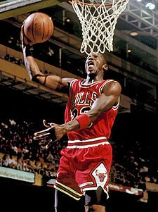 Michael Jordan up for one of his famous slam dunks. He was known for playing in the zone.