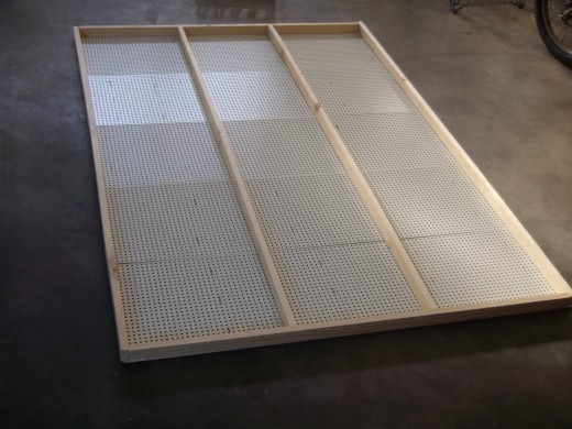 Attach frame to pegboard.