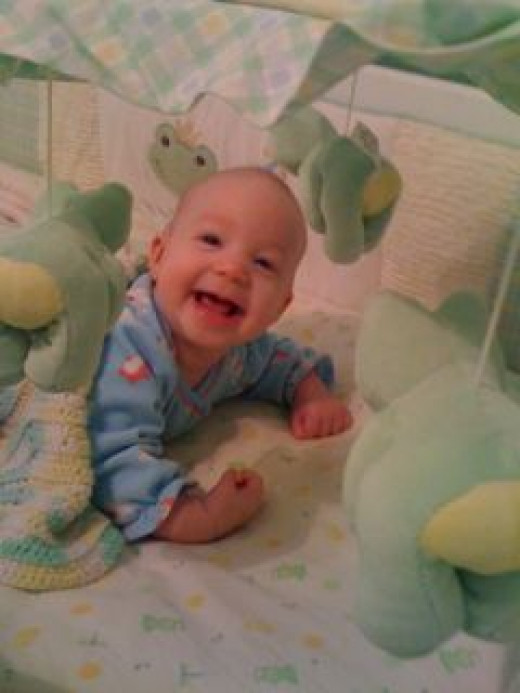 pic of happy baby in crib