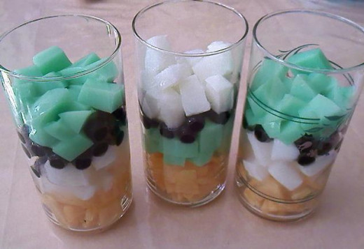 Then add agars and tapioca pearls. Layer it according to your liking. I had put the cantaloupe at the bottom of all three and decided to make the center different, which green agar came next.