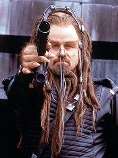 """John Travolta with the world's longest piece of snot on his face in """"Battlefield Earth"""""""