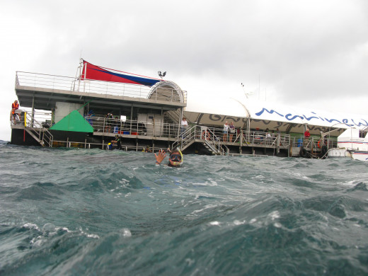 The dive pontoon, plus hubby waving.