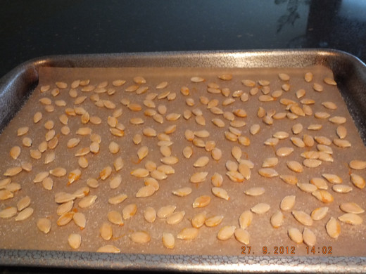 Transfered the semi-dry seeds to parchment paper. Sprinkle a small amount of salt on top.