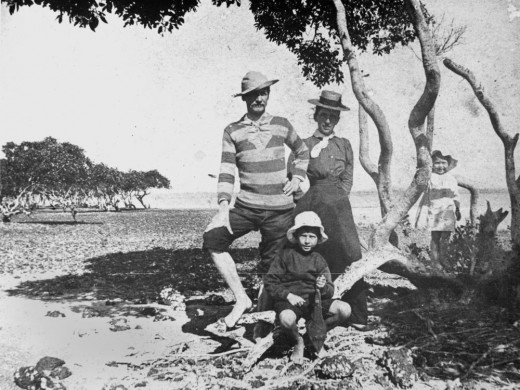 This man and his family are enjoying a summer day.  All look relaxed and refreshed.  Taken in Queensland between 1890-1900.