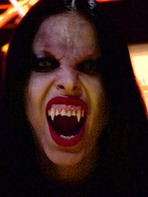 Vampires are often human looking with long fangs.