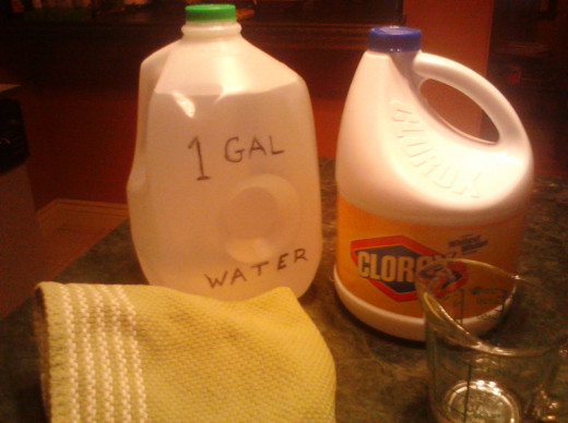 After cleaning under the stove I used 1 gallon of water to 1 cup of bleach to disinfect any germs.