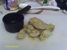 Coarsely chop the artichoke hearts and add to the sausage mixture