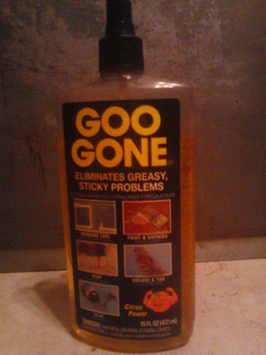 "To get rid of that grease strip between the wall and the stove I relied on the product ""Goo Gone""."