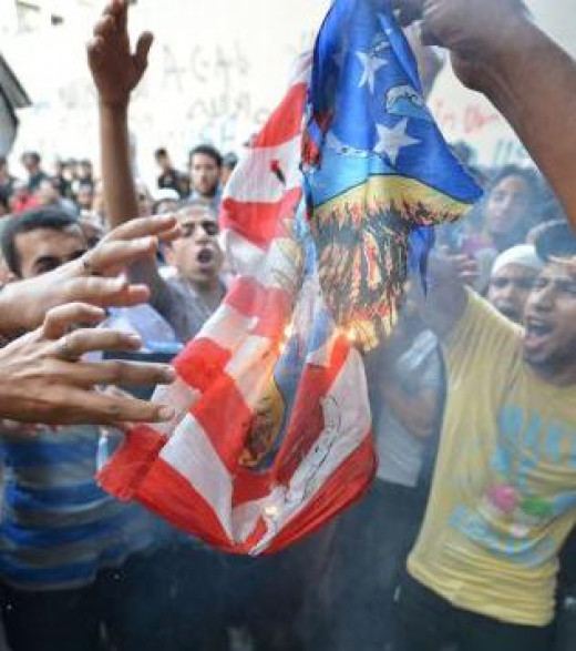Egyptians burning the American flag in protest of America's policies and Middle East actions
