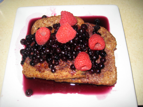 guilt-free french toast with frozen organic wild blueberries, blueberry maple syrup sauce and fresh raspberries.