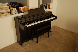 $75 on craigslist.  It is a bit dated with a 3.5in floppy disk drive but it has the feel of a traditional piano and a place to plug in headphones so my daughter can practice any time she wants to.  New these pianos cost $4500.