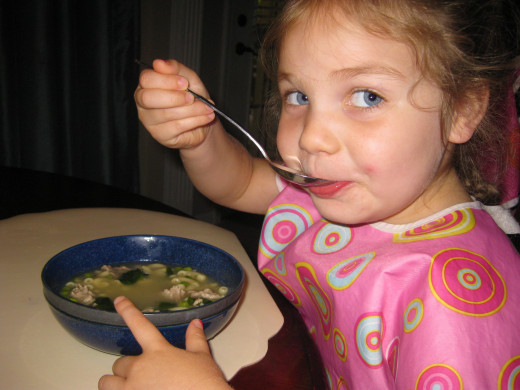 pic of girl eating soup