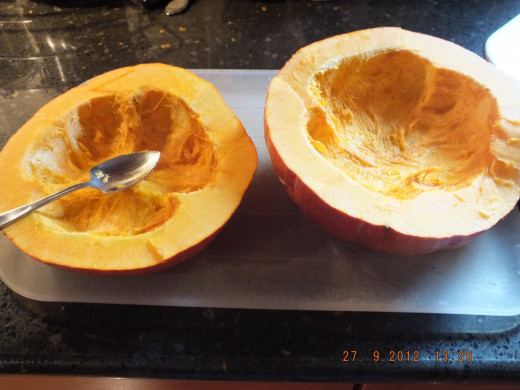All scooped out. I save the seeds in a colander. Set aside until you have the pumpkin in the oven.