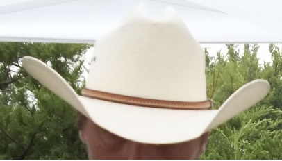 This is a newer cowboy hat and had a good-looking cowboy underneath, but I did not get permission to show his face.