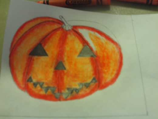 Here I am almost finished coloring in the jack-o'-lantern.