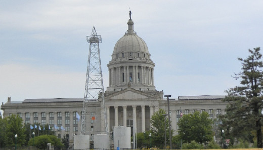 This is a south view of the Capitol Building.  The Guardian is seen atop as described.  An oil well is situated out from the south plaza of the building.