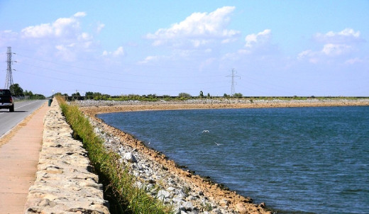 Lake Hefner, a large man-made water source for Oklahoma City and surrounding area.  Note how the water level is about six feet below normal by the red silt layer showing on the rock dam.