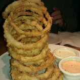 Cheddars appetizer - Onion rings with red sauce and ranch sauce