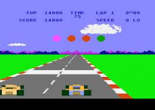 Pole Position for the Atari 2600 had a steering wheel addition. At the arcade you sat in a makeshift car with breaks, gas pedal, steering and an optional gear shift.