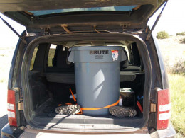 Heavy-duty plastic trash can with our rattlesnake inside.