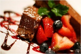 Chocolate squares with blueberries and strawberries